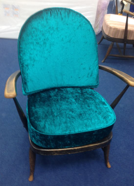 An Ercol Armchair covered in a bright modern chenille fabric