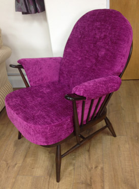 A re-upholstered Ercol chair in a modern pink fabric