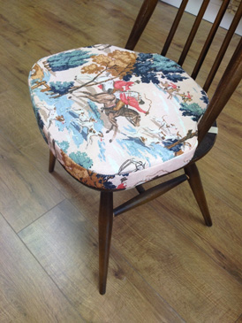 A dining chair cushion re-covered in a 'hunting' themed fabric