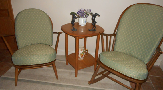 Two Ercol armchairs re-upholstered to a customer's requirements