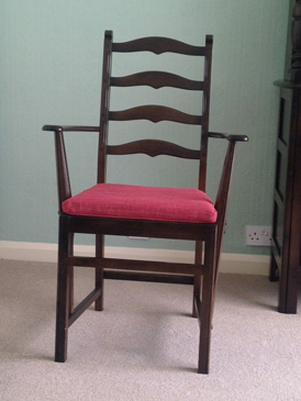 A re-upholstered Ercol dining chair returned to the customer