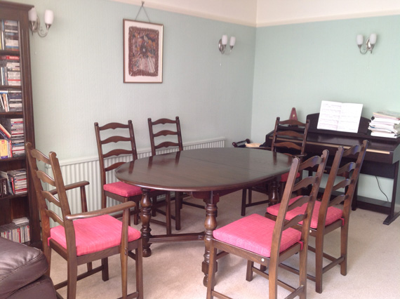 A set of re-upholstered Ercol dining chairs