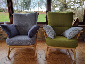 2 Ercol conservatory chairs uplolstered in contrasting fabrics