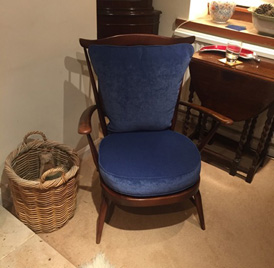 A customer's newly re-upholstered Ercol chair in a dark blue velvet fabric
