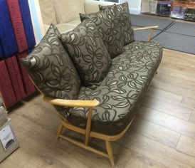 A re-upholstered Ercol sofa in a modern patterned fabric
