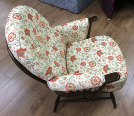 A re-upholstered Ercol armchair in a traditional 'chintz' fabric